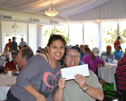 Angelica, Gompers Client passing out raffle prizes to lucky winners!