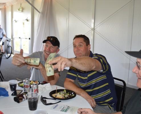 Golfers digging deep for raffle tickets!
